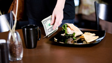 "A recent decision to outlaw tipping in an NYC restaurant a ""tipping point"" in the ongoing row over restaurant wages"